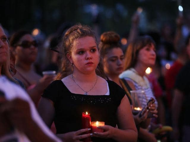 People attend a memorial service on June 19 in Orlando, Florida.