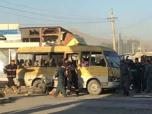 Police and fire fighters are seen at the site of a blast in Kabul.