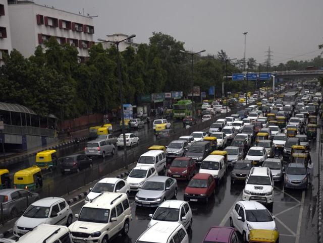 Traffic moves slowly on a rainy day as the Capital received its first pre-monsoon showers, bringing down the mercury by several degrees  on Monday.