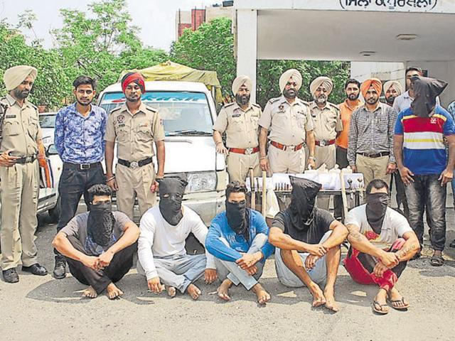 The police have recovered four pistols, a .12-bore rifle, a country-made pistol and 29 live cartridges, besides 1.3kg of heroin, a Toyota Qualis (PB-08-AK-3666) and sharp-edged weapons from their possession.