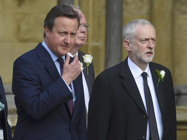 Britain's Prime Minister David Cameron (left) walks from Parliament to St Margaret's Church with Jeremy Corbyn, (centre) the leader of the opposition Labour Party, for a service of remembrance for Labour MP Jo Cox, who was murdered last week.