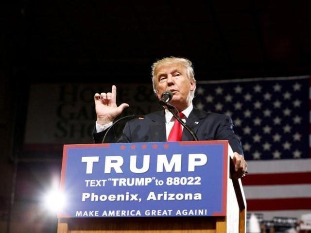 Republican U.S. Presidential candidate Donald Trump speaks at a campaign rally in Phoenix, Arizona, June 18, 2016. REUTERS/Nancy Wiechec