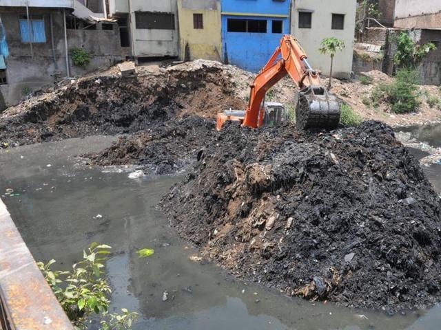 Palasia nullah chocked with garbage.
