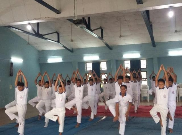 NCC cadets from Hansraj Morarji Public School in Andheri during an early morning yoga session on Tuesday.