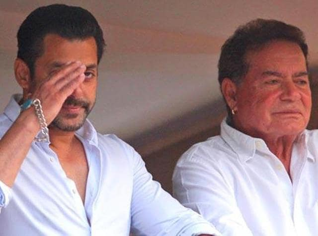 Salman and Salim Khan greeting fans from the balcony of their Juhu house. (AP Photo)