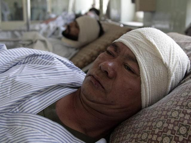 An injured Nepalese security guard receives treatment at a hospital in Kabul.