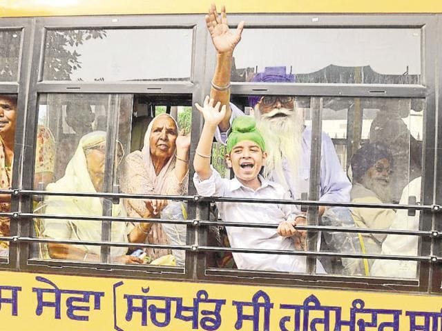 Sikh pilgrims waving as they leave for Pakistan to attend a function to mark the 177th death anniversary of Maharaja Ranjit Singh.