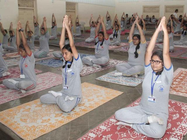 Students perform Yoga during International Yoga Day at Rajhans School, Andheri in Mumbai on Tuesday.