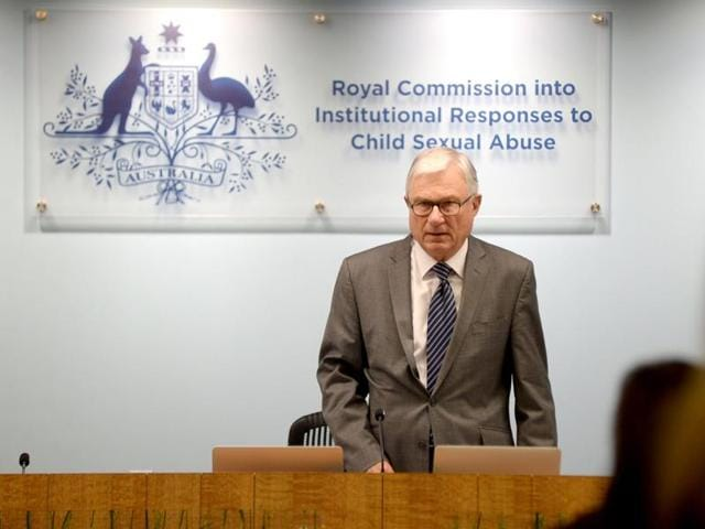 This handout photo taken and released from the Royal Commission into Institutional Responses to Child Sexual Abuse on June 21, 2016 shows Commissioner Peter McClellan, head of the Royal Commission into Institutional Responses to Child Sexual Abuse, during the commission's public hearing in Sydney into the Australian Defence Force.