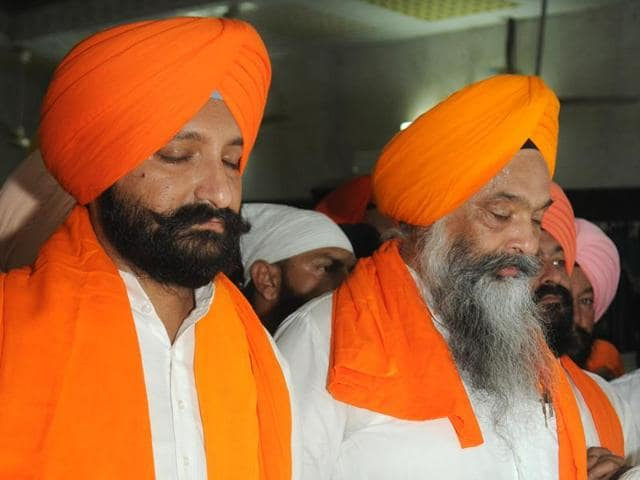 From right: SAD MP Prem Singh Chandumajra with his son and the newly-appointed Sanaur segment party in-charge Harinder Pal Singh Chandumajra at the Bahadurgarh gurdwara near Patiala on Monday.