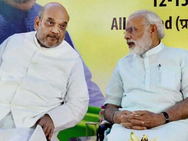 Prime Minister Narendra Modi interacts with BJP's national president Amit Shah during the party's national executive meet in Allahabad.