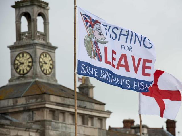 A pro-Brexit flag flies from a fishing boat moored in Ramsgate on June 13, 2016.