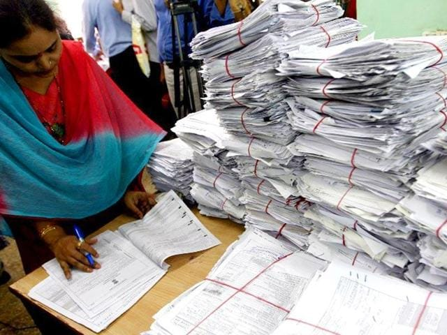 Officials scrutinising a tax return form in New Delhi.
