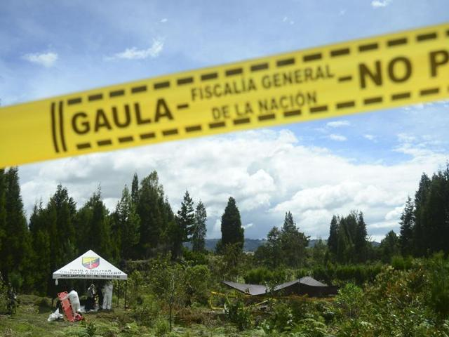 Members of the Technical Investigation Team of the Office of the Attorney General inspect corpses found in a mass grave at a farm in Guarne municipality, Antioquia department, Colombia on June 20, 2016. Colombian authorities are investigating Jaime Ivan Martinez, who told the police he killed 20 people including his wife and two young children, a prosecutor said.