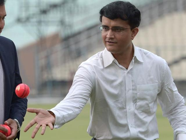 Former Indian cricket captain and current president of the Cricket Association of Bengal (CAB) Sourav Ganguly (right) and former Indian batsman VVS Laxman play with a pink cricket ball during an event at the Eden Gardens ground in Kolkata.
