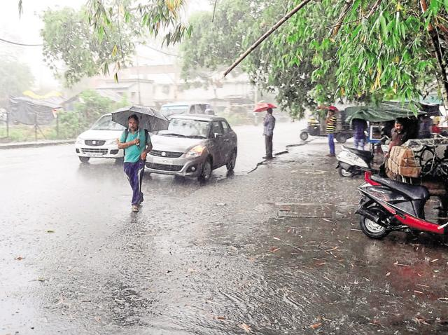Rain lashed the state capital on Tuesday amid Met's warning of heavy rainfall in isolated places in Uttarakhand.