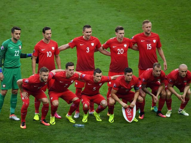 Poland's national football team pose for a picture ahead of the start of the Euro 2016 group C football match between Germany and Poland at the Stade de France stadium in Saint-Denis, near Paris.