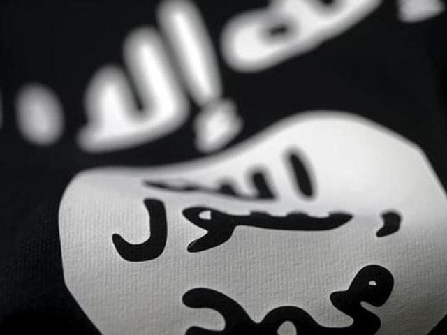 An Islamic State flag is seen in this picture illustration.