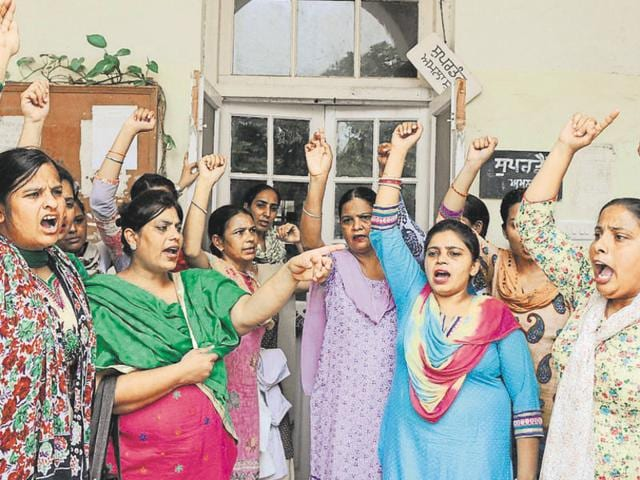 """Nurses and ancillary staff union chief Karamjit Kaur said: """"Though the medical education secretary assured us of regularisation, we will not end our protest until we get a copy of the notification. We were told that cabinet would decide about the notification."""""""