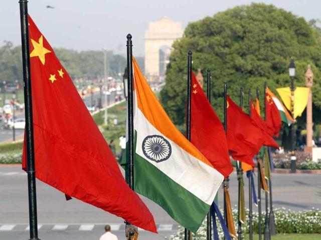 The national flags of China and India at Vijay Chowk on Rajpath.