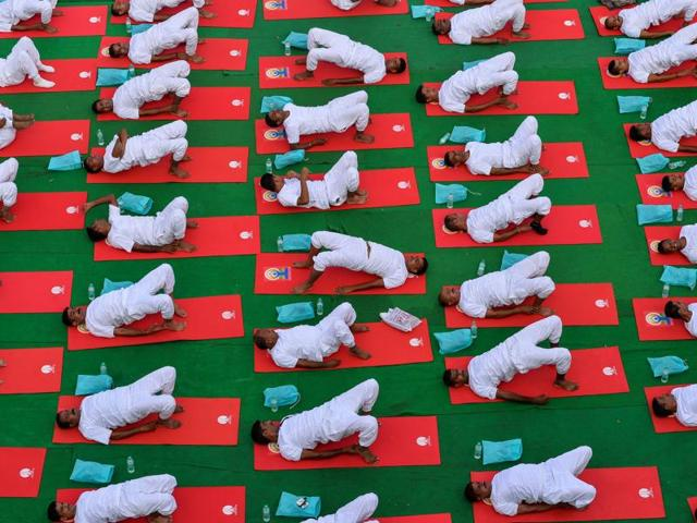 People participate in a mass yoga session on International Yoga Day in New Delhi.