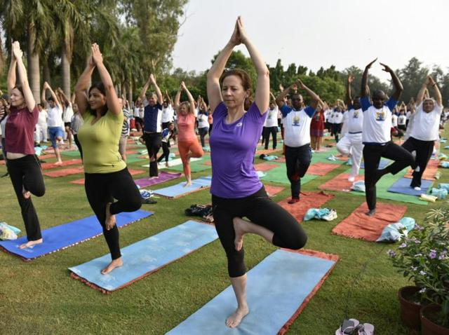 People perform yoga exercise at Nehru Park in Delhi.