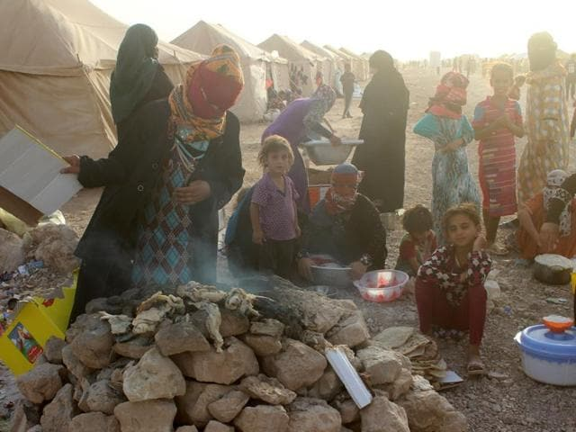 Displaced Iraqis from the embattled city of Fallujah are seen at a camp on June 20, 2016 in Amiriyiah al-Fallujah.