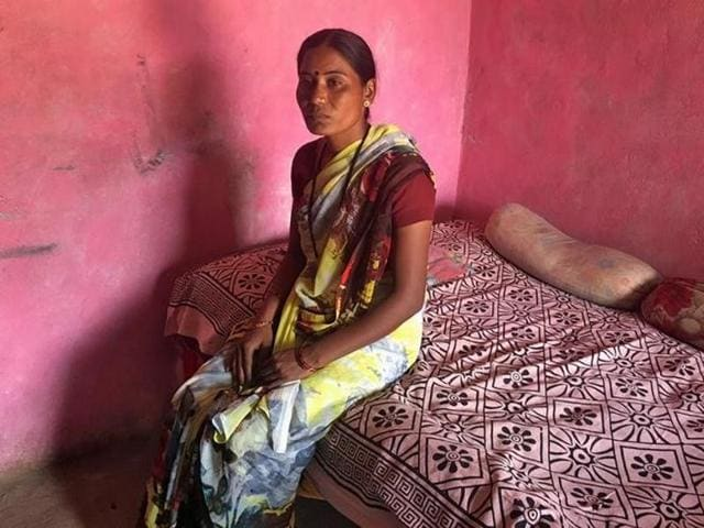 Joshna Wandile, a widow, poses inside her two-room house in Alipur village in Maharashtra.