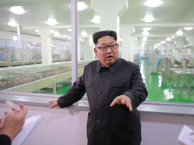 This undated picture released from North Korea's official Korean Central News Agency on June 16, 2016, shows North Korean leader Kim Jong-Un inspecting the Pyongyang cornstarch factory in Pyongyang.