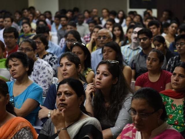 Students and parents at an Open Day session in Zakir Husain College in New Delhi.