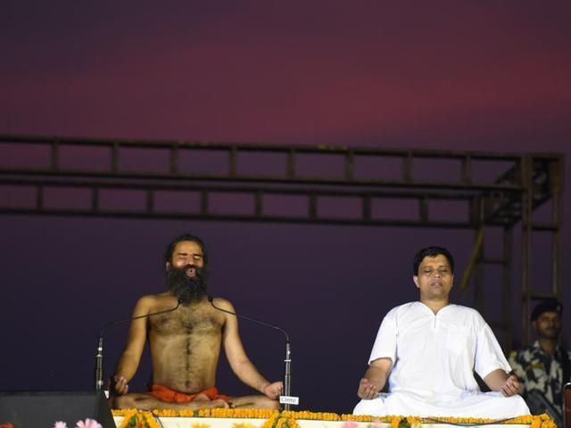 Baba Ramdev and Acharya Balkrishna perform Yoga during the rehearsals for the upcoming International Yoga Day at Rajpath, in New Delhi, India on Sunday, June 19, 2016.