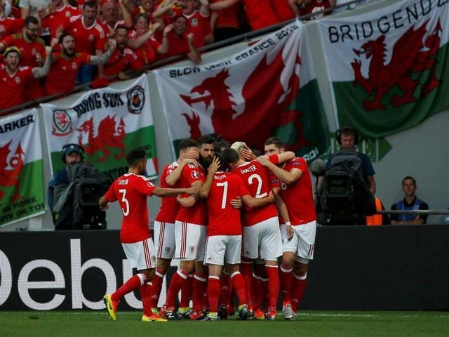 Wales' players celebrate after scoring a goal during their match against Slovakia at Stade de Toulouse, Toulouse, France.