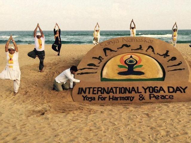 Sand artist Sudarsan Pattnaik has created a 'Surya Namaskar' sand sculpture on the occasion of International Yoga Day at Puri beach of Odisha.