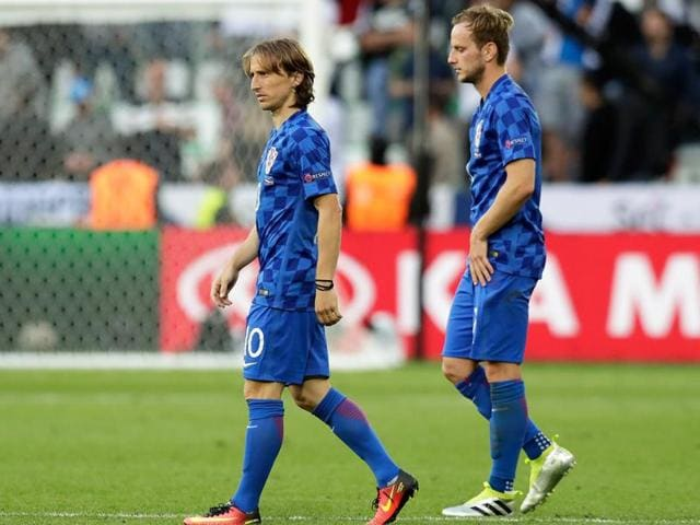 Croatia's Luka Modric (left) and Ivan Rakitic leave the pitch at the end of the Euro 2016 Group D football match between the Czech Republic and Croatia at the Geoffroy Guichard stadium in Saint-Etienne, France.