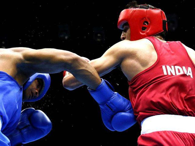 Sumit Sangwan, right, needs one more win to guarantee his Rio Olympics berth.