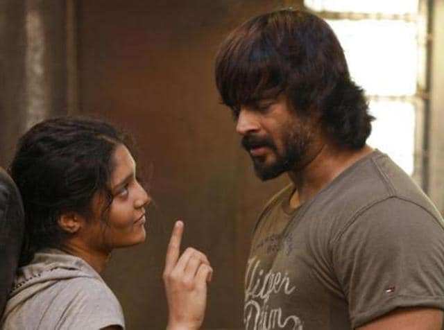 Madhavan in a scene from Saala Khadoos with Ritika Singh.