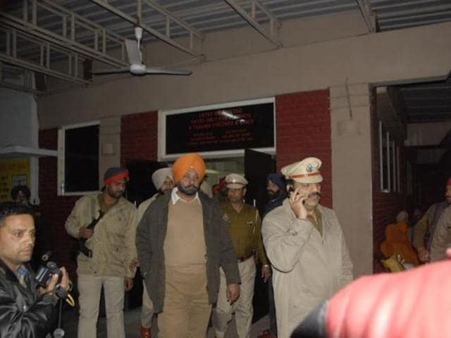 Police at the hospital after Amit Arora was attacked in  February.
