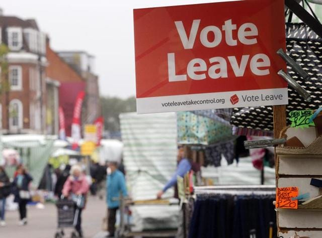 A Vote Leave sign is fixed on a market stall at Havering's Romford street market in London.