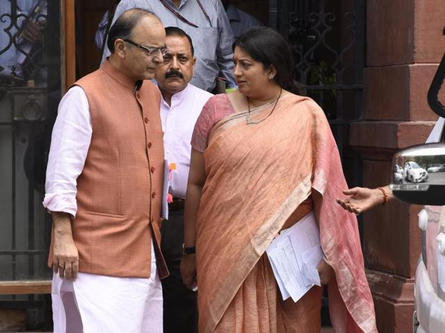 Union finance minister Arun Jaitley, human resource development minister Smriti Irani and minister of science and technology Jitendra Singh after a cabinet meeting at South Block in New Delhi.