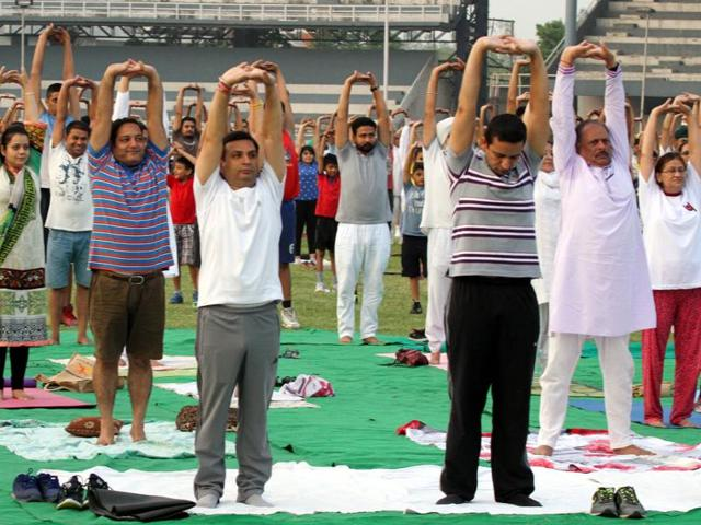 Participants performing yoga during a programme to celebrate International Yoga Day at the Guru Nanak Stadium in Ludhiana on Tuesday.