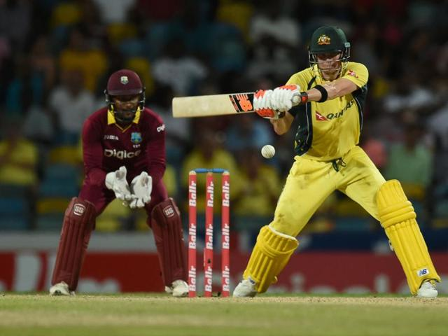 Australian cricket team captain Steven Smith plays a shot during the 8th One Day International match of the tri-nation series between Australia and West Indies at the Kensington Oval stadium in Bridgetown.