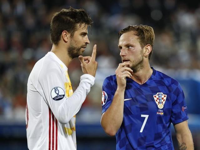 Spain's Gerard Pique and Croatia's Ivan Rakitic during their Euro 2016 match Stade de Bordeaux, Bordeaux, France.