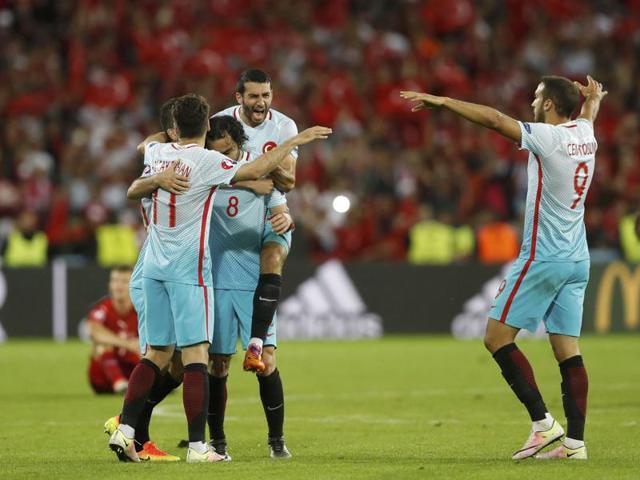 Ozan Tufan celebrates after scoring Turkey's second goal.