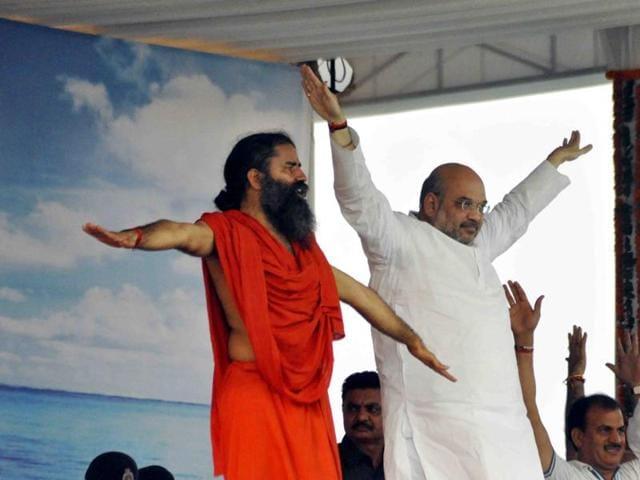 BJP president Amit Shah with yoga guru Ramdev during the International Yoga Day function in Faridabad on Tuesday.