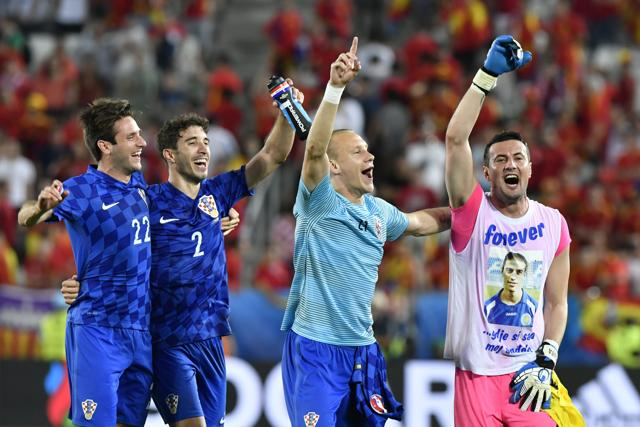 Croatia's players celebrate their victory during the Euro 2016 group D football match between Croatia and Spain at the Matmut Atlantique stadium in Bordeaux.