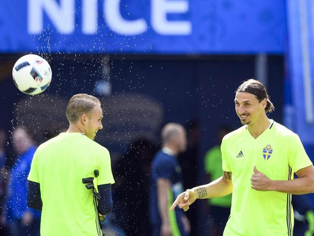 Sweden's forward and team captain Zlatan Ibrahimovic (right) and his teammate attends a training session at the Allianz Riviera stadium in Nice, on the eve of the Euro 2016 football match between Sweden and Belgium.