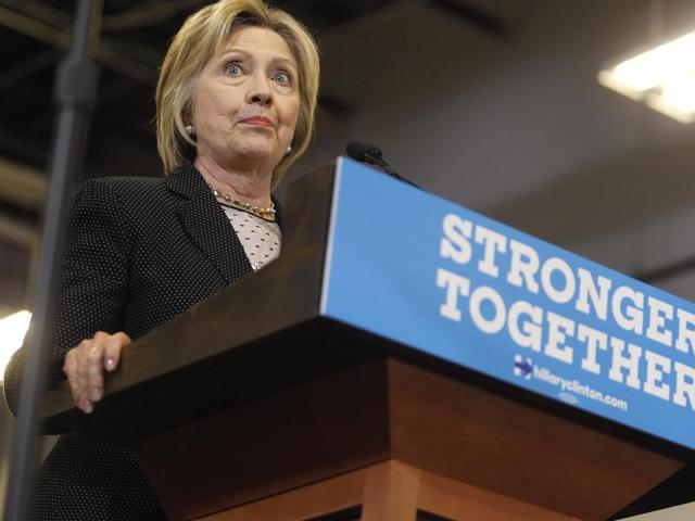 Democratic US presidential candidate Hillary Clinton speaks during a debate in Flint, Michigan.