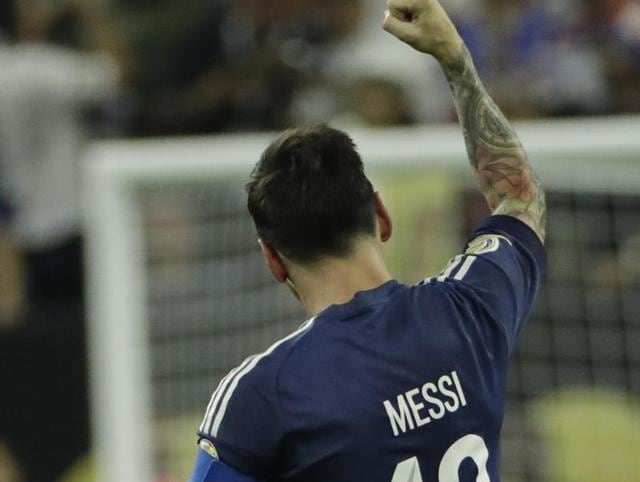 Argentina midfielder Lionel Messi (10) celebrates with teammates after scoring a goal during the first half against the United States in the semifinals of the 2016 Copa America Centenario at NRG Stadium.
