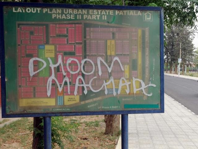 A layout map at Urban Estate lying defaced with graffiti in Patiala.