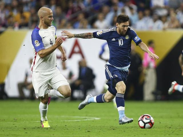 Argentina midfielder Lionel Messi (10) advances the ball as United States' Michael Bradley defends during the first half in the semifinals of the 2016 Copa America Centenario football tournament at NRG Stadium.